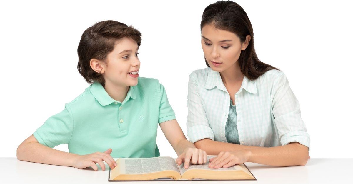 Boy and teenager girl studying
